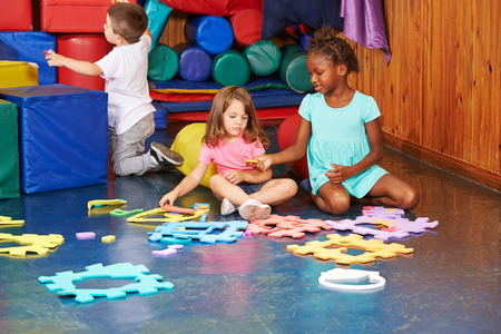 playschool: Group of children playing together in a kindergarten Stock Photo