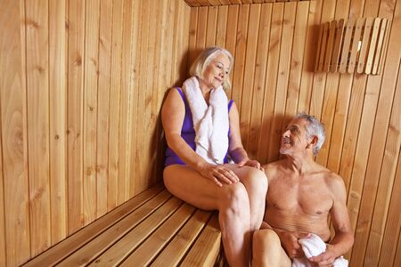 Senior people sweating in sauna of hotel in their holidays Stock Photo