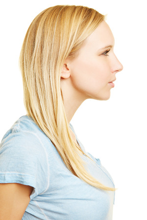 woman serious: Profile of young blonde woman in side view