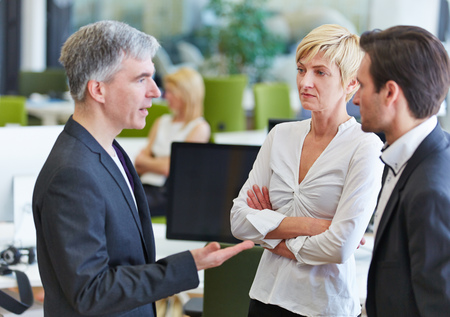team communication: Business team communication in the office with elderly businessman talking