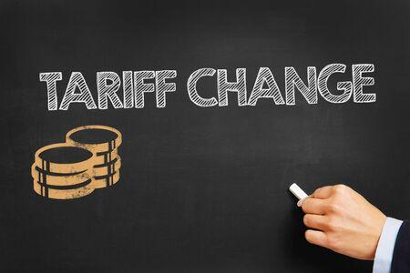 fuel provider: Hand writes Tariff Change on blackboard