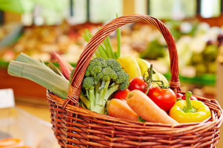 grocery shopping cart: Colorful fresh vegetables in a shopping basket in a supermarket