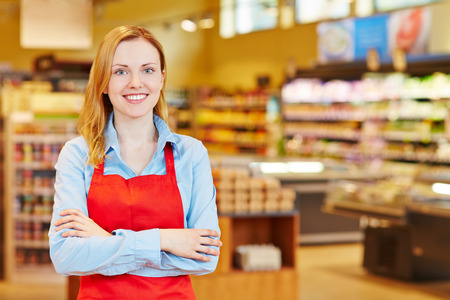 Young happy smiiling woman doing apprenticeship in a supermarket Stock Photo - 40290404