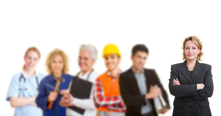 Business woman standing in front of a team with different occupations and trades photo