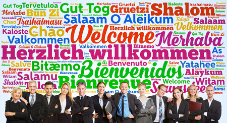 Successful business team saying welcome in tag cloud with many languages photo