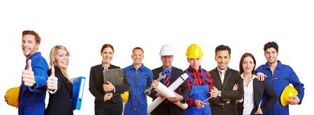 Witte en blauwe boorden-werknemer als een team houdt thumbs up Stockfoto
