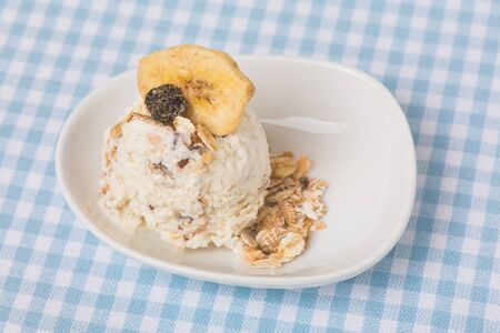 yogurt ice cream: Healthy scoop of granola ice cream with dried fruits and cereal Stock Photo