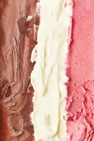 neapolitan: Stripes of neapolitan ice cream from above with chocolate, vanilla and strawberry ice cream Stock Photo