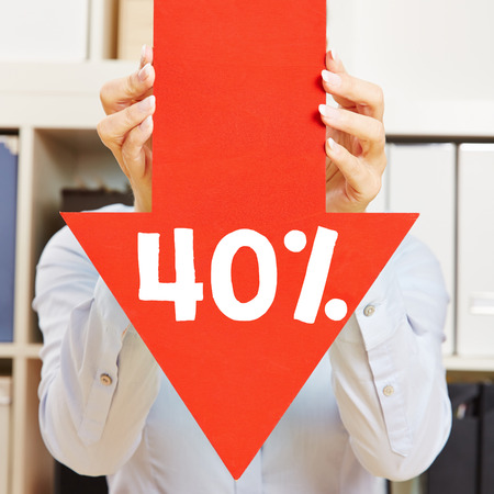 slump: Red arrow with 40% discount being held by female hands