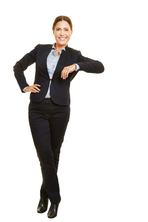 Smiling isolated full body business woman leaning casual on imaginary object