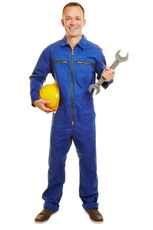 boiler suit: Smiling isolated full body builder with yellow helmet and boiler suit Stock Photo