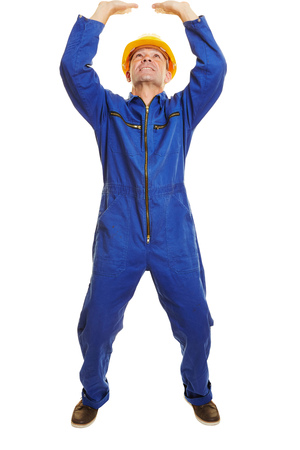 boiler suit: Fully body isolated construction worker lifting a heavy imaginary object