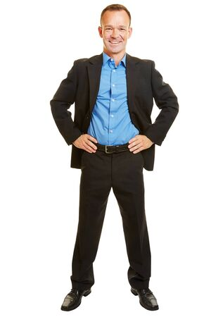 arms akimbo: Smiling full body businessman with standing his arms akimbo isolated on white