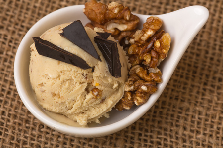 chocolate pieces: A scoop of fresh homemade walnut ice cream with chocolate pieces