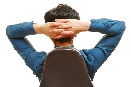 man behind: Business man sitting on an office chair from behind with hands behind his head Stock Photo