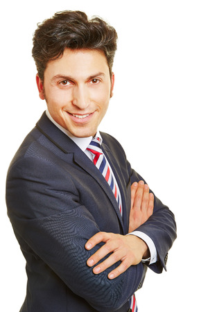 headshot: Headshot of smiling business manager with his arms crossed