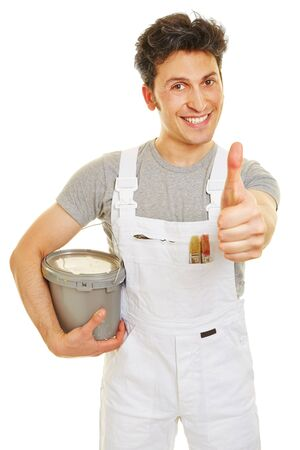paint bucket: Smiling painter with paint bucket holding his thumb up Stock Photo