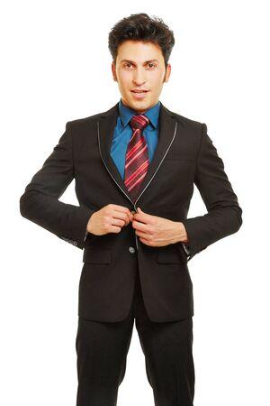 cerrando negocio: Hombre de negocios botón de cierre de traje con sus manos Foto de archivo