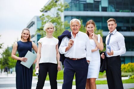 manager team: Portrait of business team with senior manager in summer Stock Photo