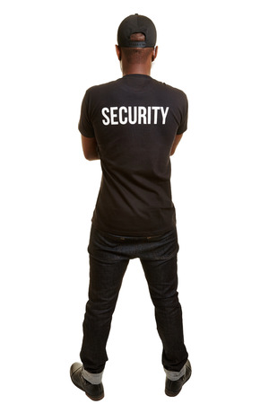 Back of black man from security firm with shirt and basecap