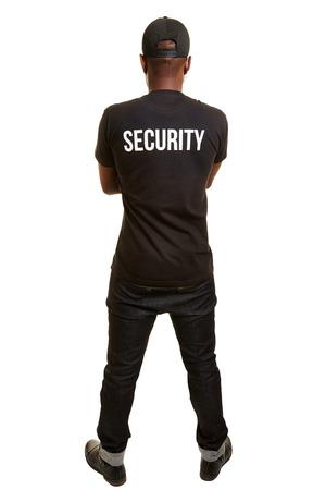 seguridad en el trabajo: Detrás del hombre negro de la firma de seguridad con la camisa y el capacete