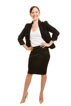 arms akimbo: Smiling businesswoman in a business suit with her arms akimbo
