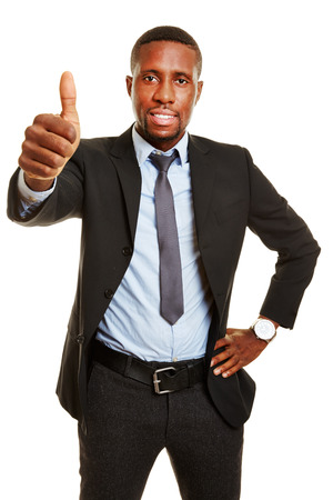 happy african: Happy african business man holding his thumbs up