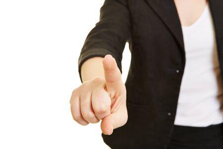 dedo indice: Dedo índice de la mano femenina usando la pantalla táctil virtual de