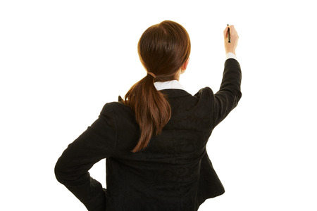 mujer de espaldas: Mujer de negocios detr�s de la escritura con un rotulador Foto de archivo