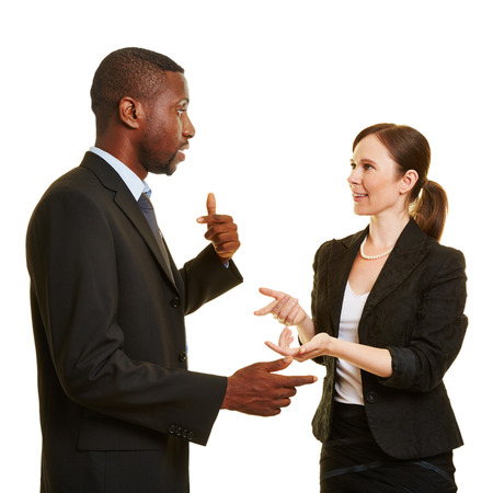 African man and caucasian woman talking together as businesspeople Standard-Bild