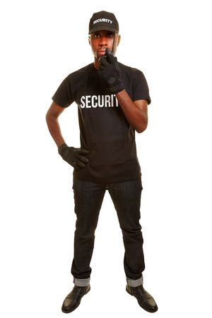security: Black man as security guard talking into radio set