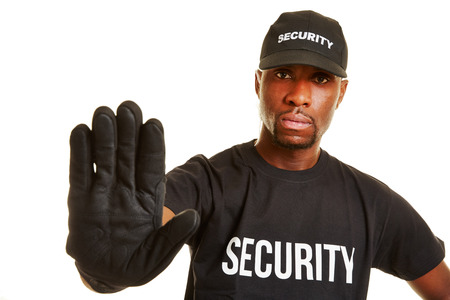 Security guard keeping distance with his hand Stock Photo