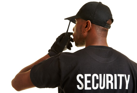 Black security man with radio set from behind
