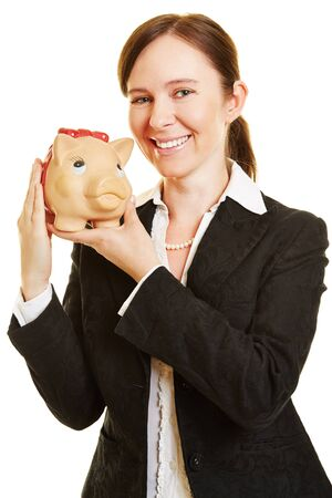 thrift box: Happy business woman with a piggy bank as money investment Stock Photo