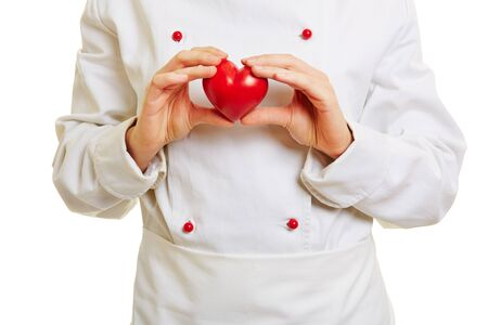 workwear: Chef cook holding a red heart in front of the workwear
