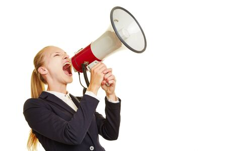 speaking tube: Young woman shouting lout and angry into a megaphone