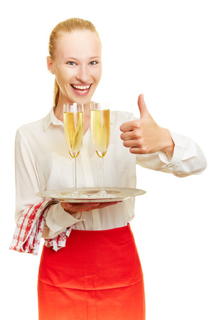 sparkling wine: Happy female waiter with sparkling wine holding thumb up Stock Photo