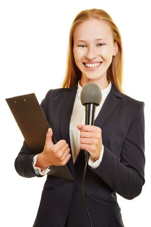 interviewing: Young female journalist with microphone and clipboard
