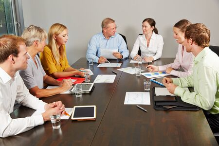 negotiating: Group of business people negotiating in a conference room