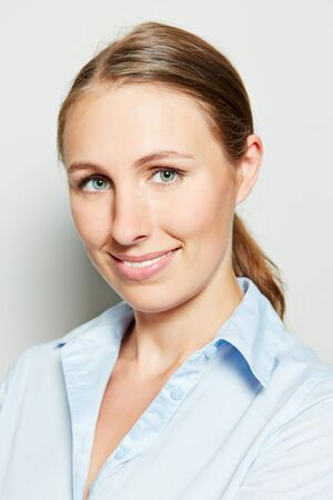 head shot: Head shot of young smiling attractive businesswoman Stock Photo