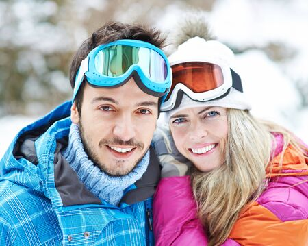 couple winter: Happy couple together on a ski trip in winter