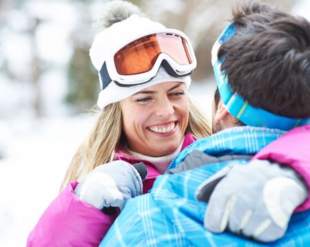 togther: Happy smiling couple togther in a winter holiday with ski goggles