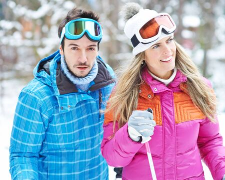 crosscountry: Man and woman doing cross-country skiing together in winter