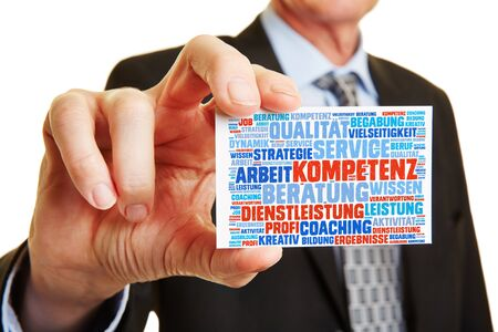 apprenticeship employee: Manager offering competence and advice as tag cloud in German on his business card Stock Photo