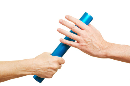 Hands offering a blue relay baton during running race Archivio Fotografico