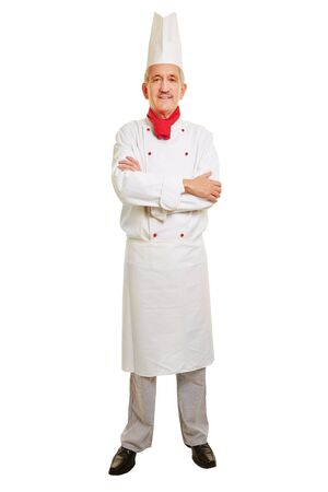 workwear: Full body shot of chef cook in workwear with his arms crossed