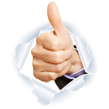 Congratulation with hands breaking through paper holding thumbs up Stockfoto