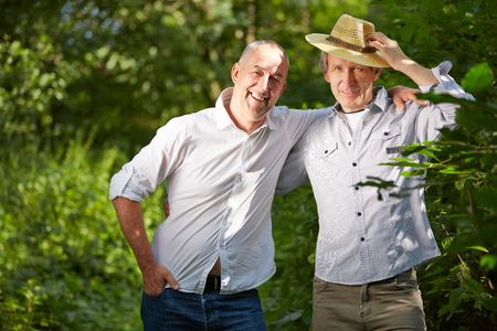happy senior: Male friendship with two senior men outside in nature Stock Photo