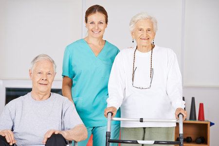 my home: Two old senior people in nursing home with a geriatric nurse