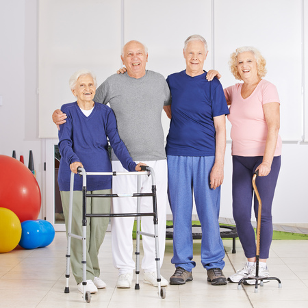 physical therapy: Happy group of senior people in physiotherapy room